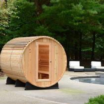 Almost Heaven Saunas' six-person Princeton barrel sauna installed next to an outdoor pool.